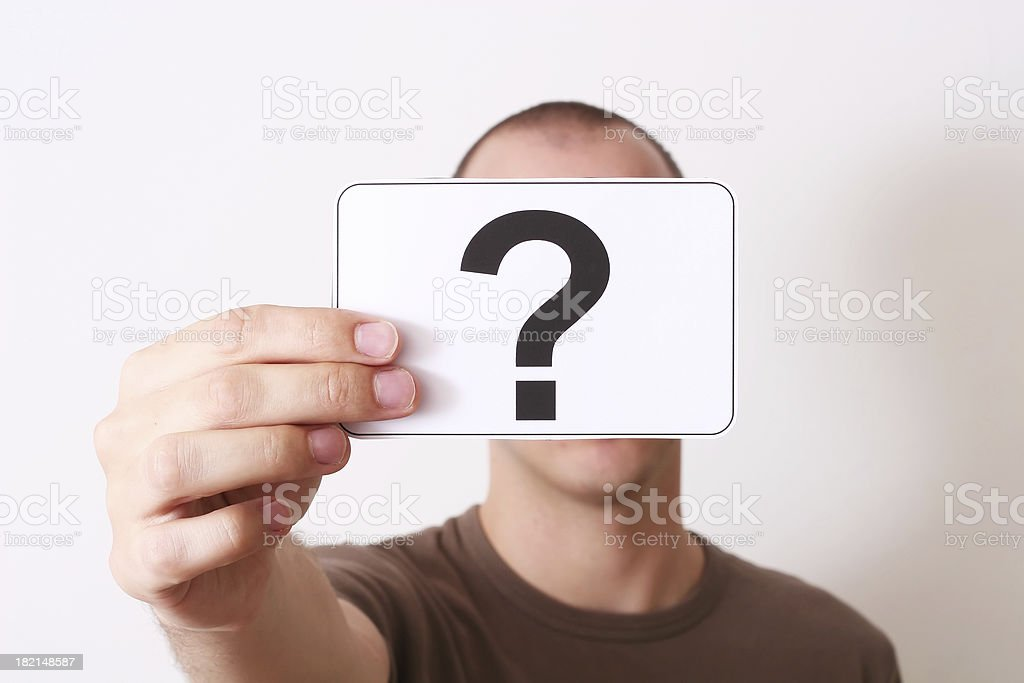 Holding question mark royalty-free stock photo