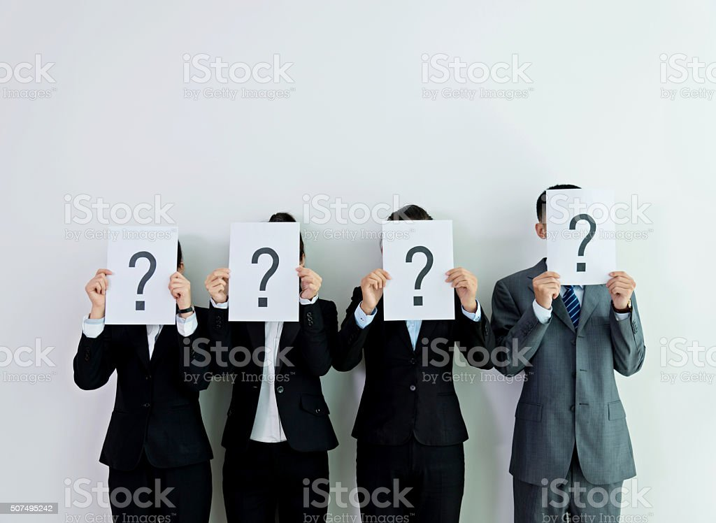 Holding question mark signs stock photo