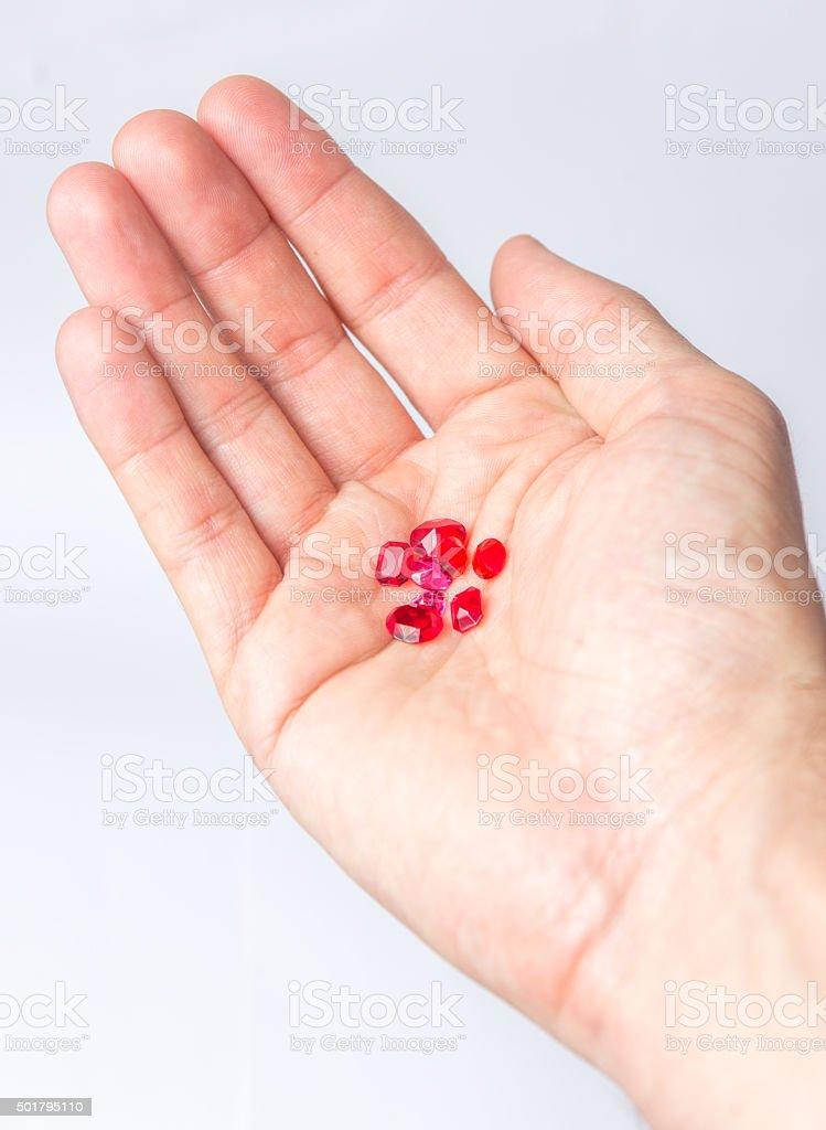 Holding red diamonds stock photo