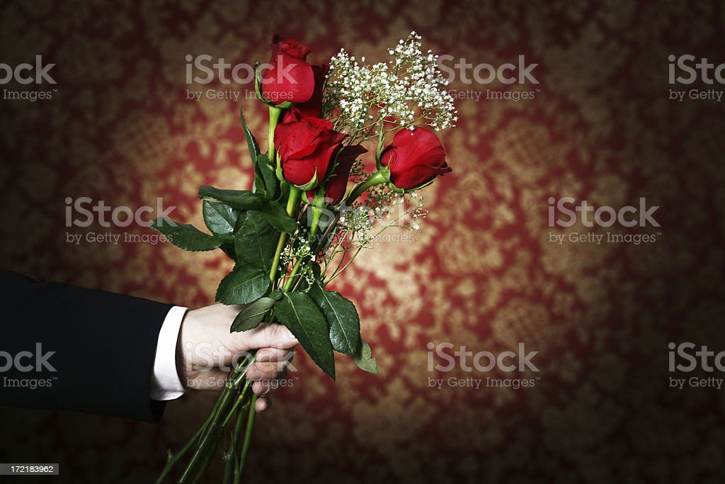Holding roses royalty-free stock photo