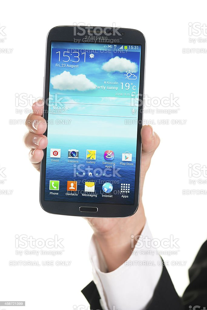 Holding Samsung Galaxy Mega royalty-free stock photo