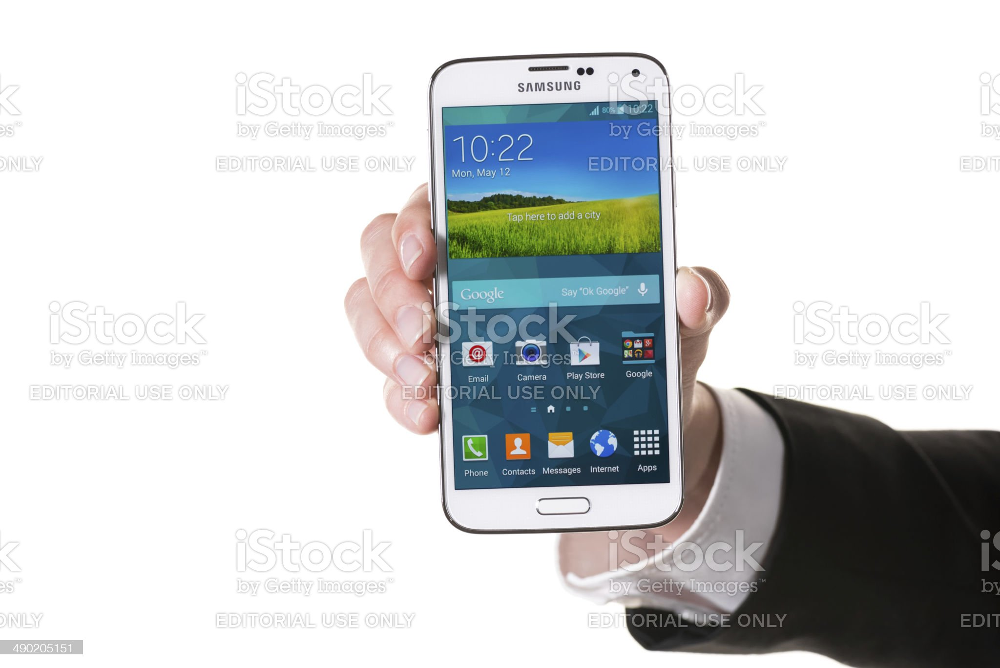 Holding Samsung Galaxy S5 royalty-free stock photo