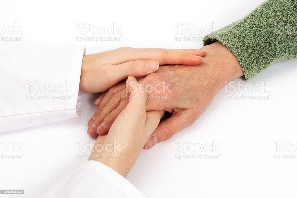 Holding senior hand care stock photo