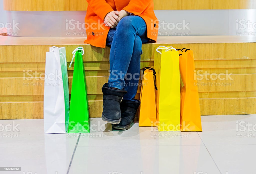 holding shopping bags stock photo