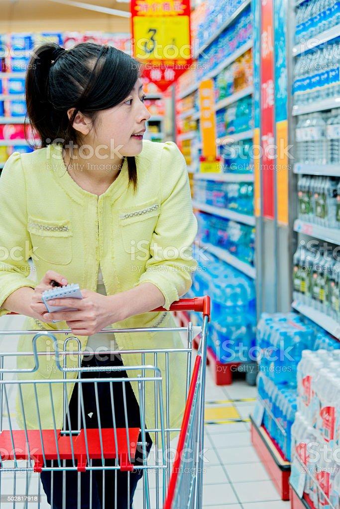 holding shopping list stock photo