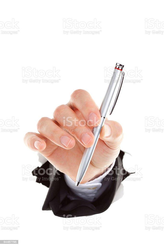 holding silver ballpoint stock photo