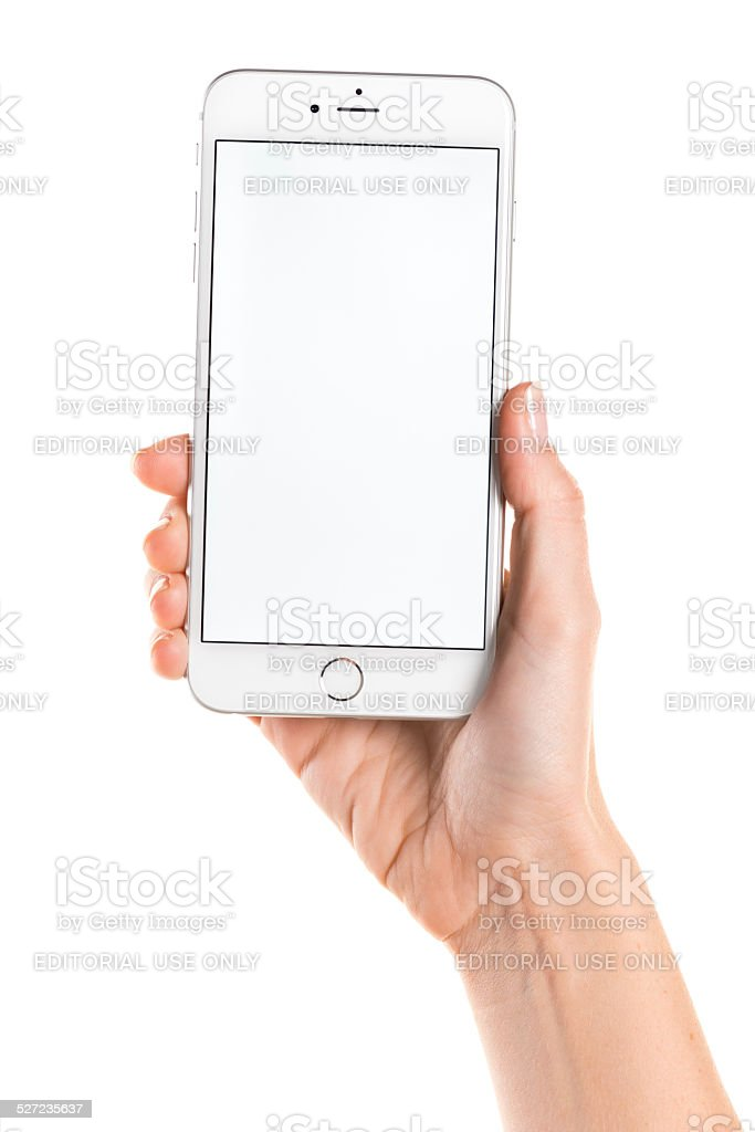Holding silver iPhone 6 Plus with white screen stock photo