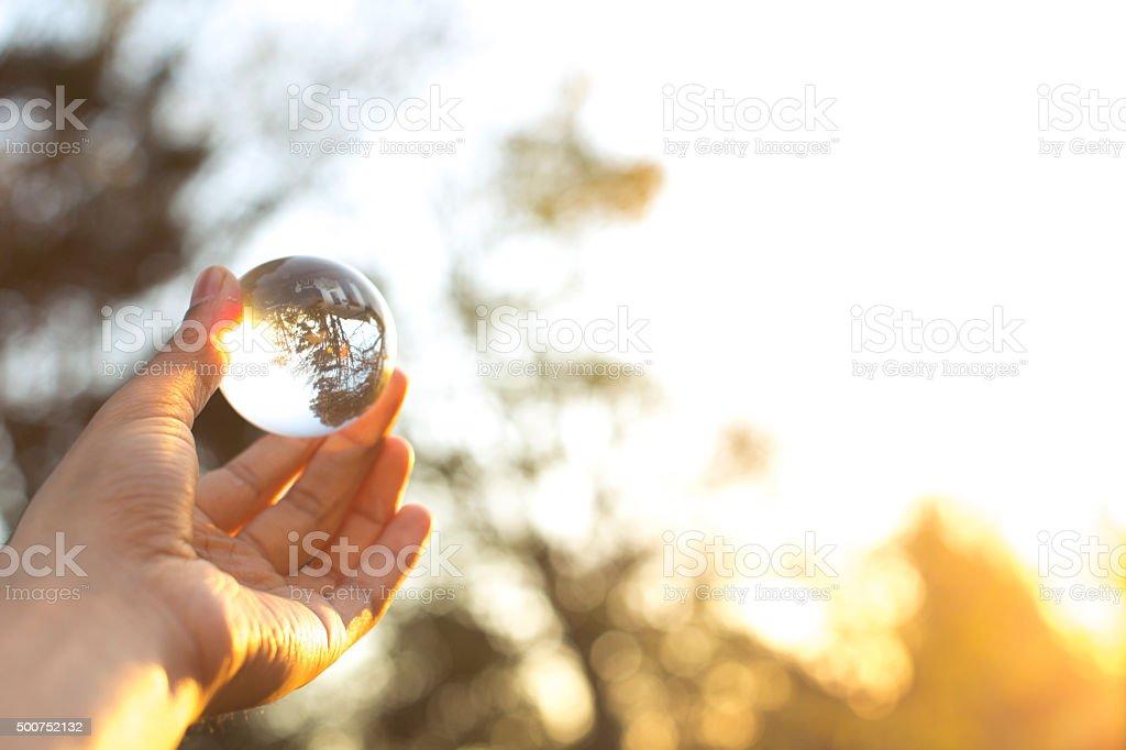 holding stress ball outdoors stock photo