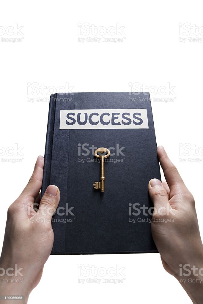 Holding success key book stock photo