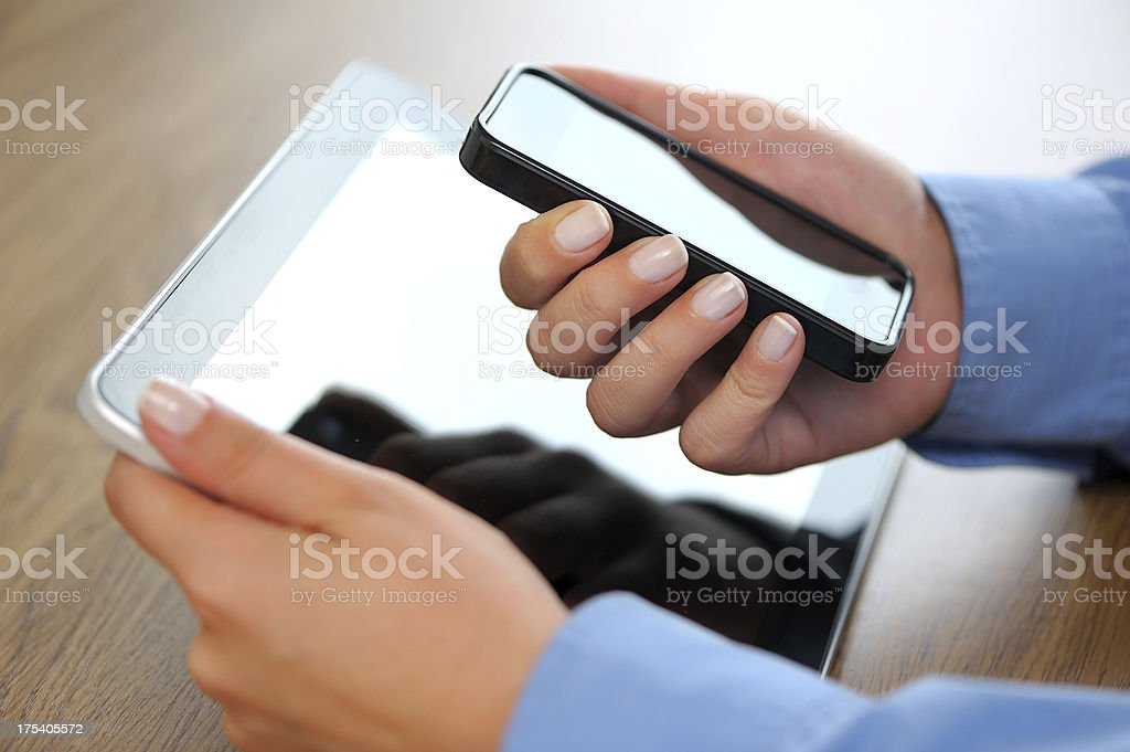 Holding tablet pc and smart phone royalty-free stock photo