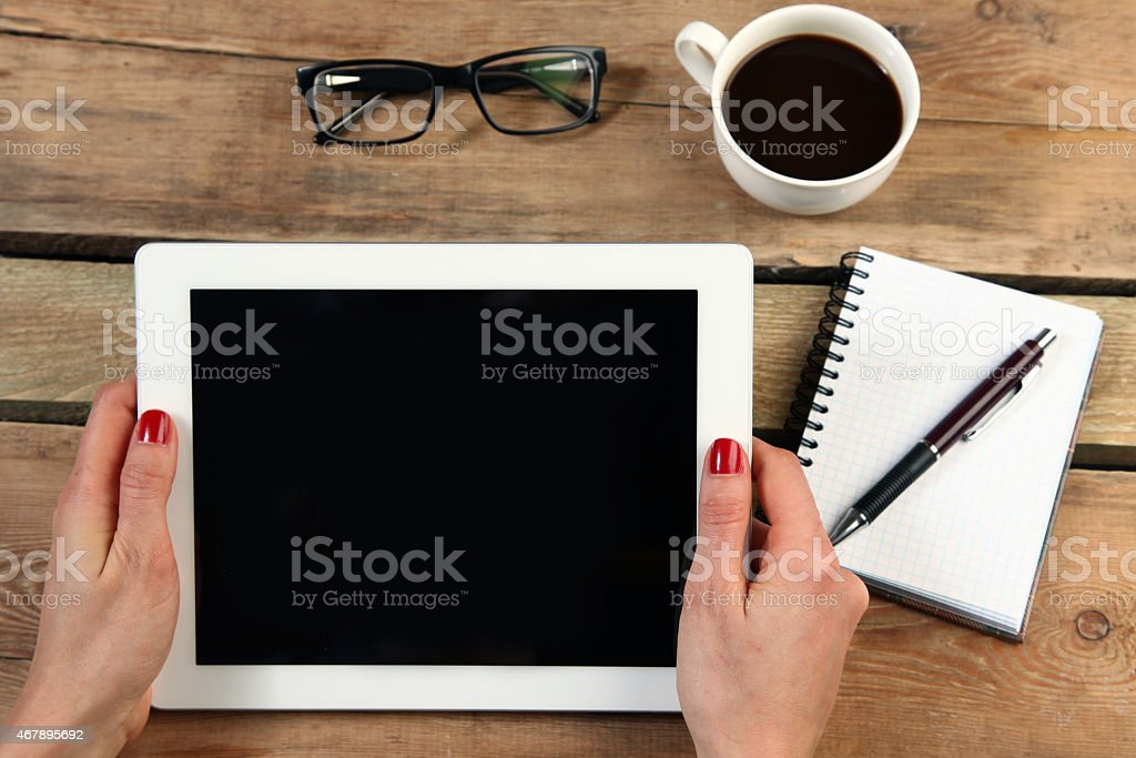 holding tablet stock photo