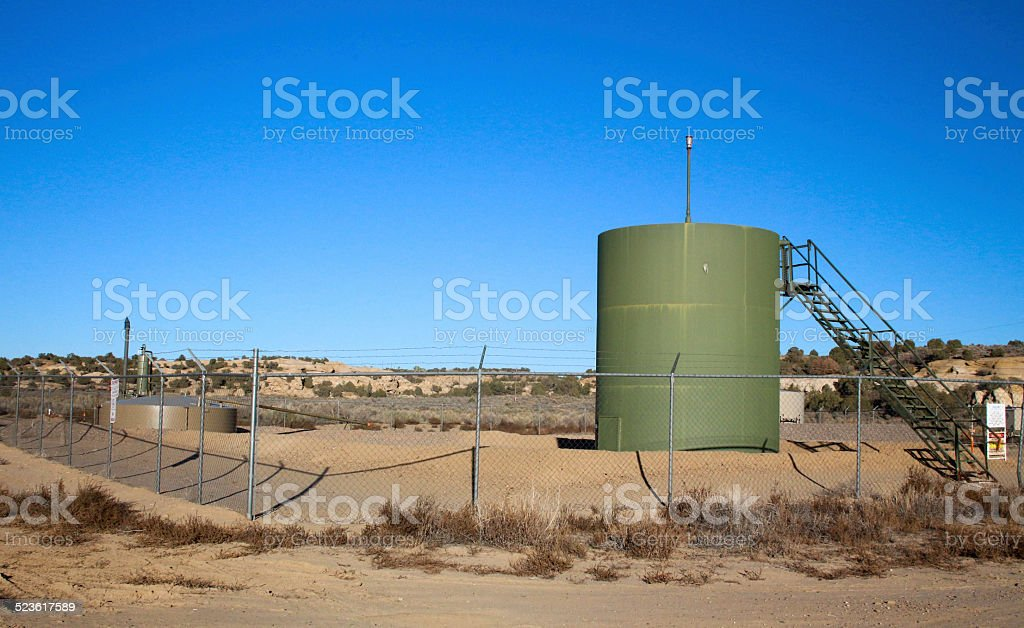 Holding tank with stairs at a natural gas fracking site stock photo