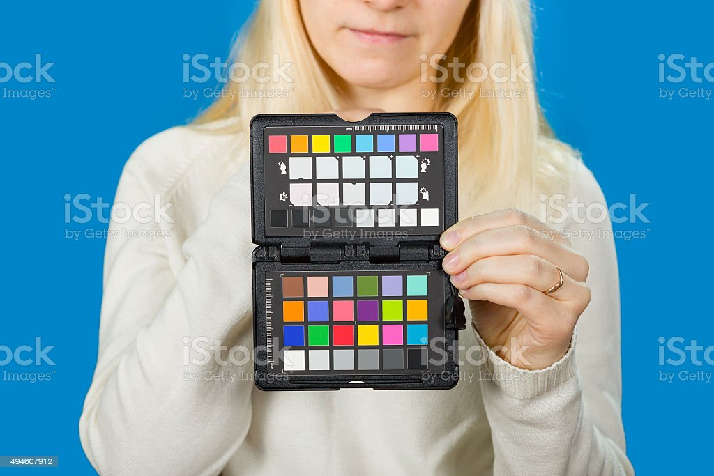 holding the camera color correction stock photo