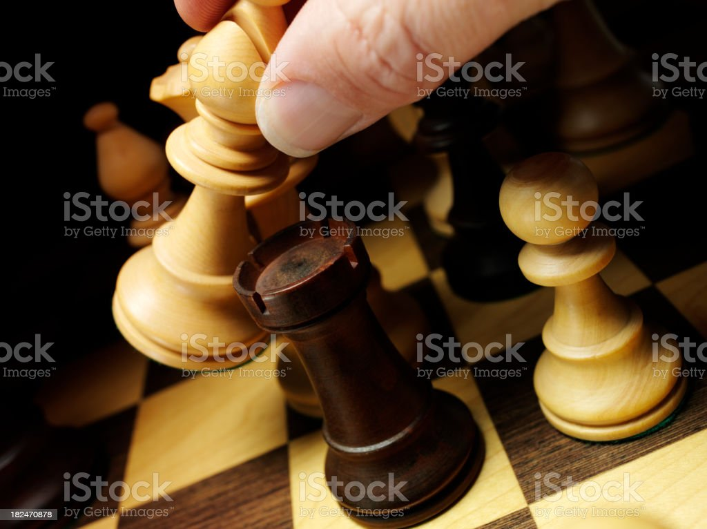 Holding the Chess Bishop stock photo