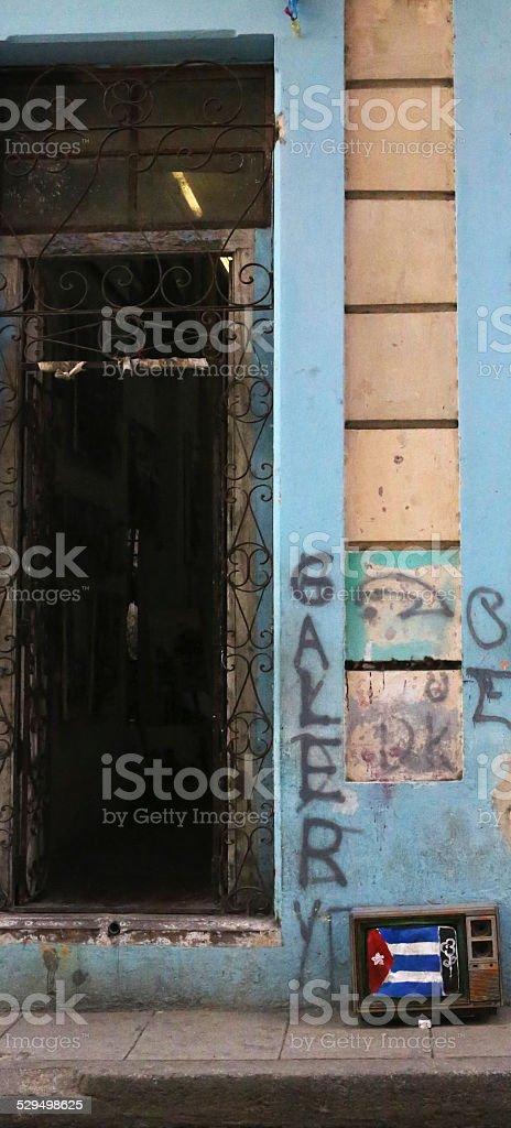TV holding the Cuban Flag in Havana stock photo