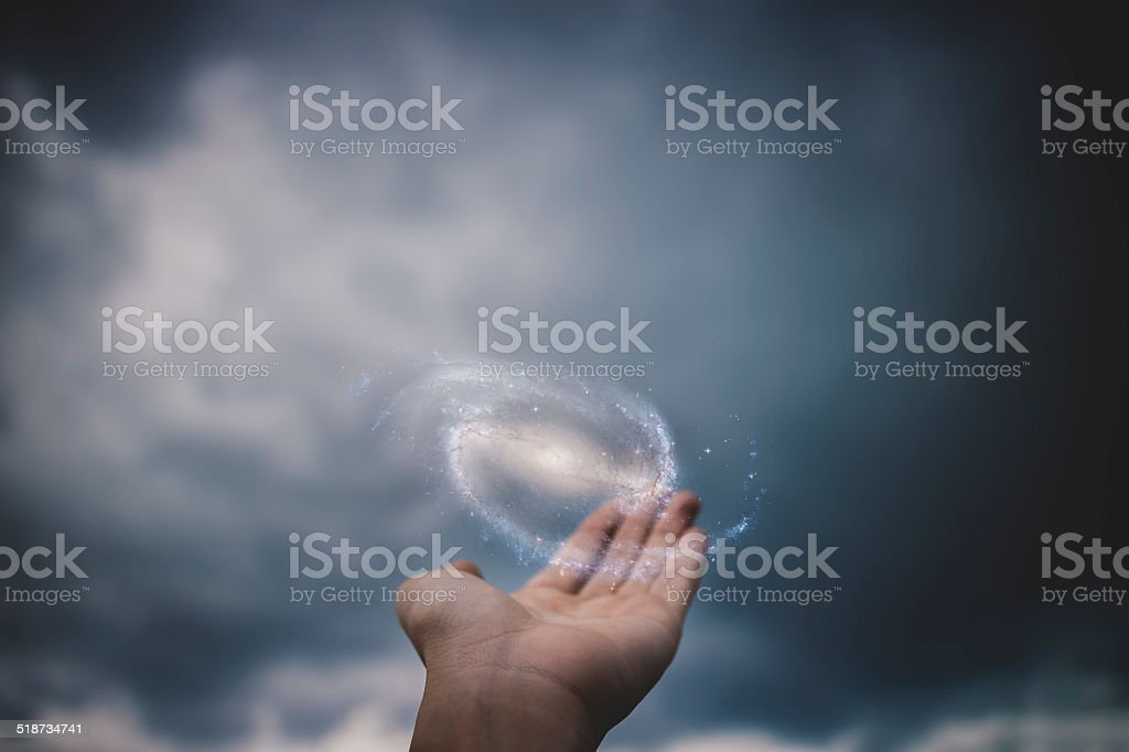 Holding the Galaxy stock photo