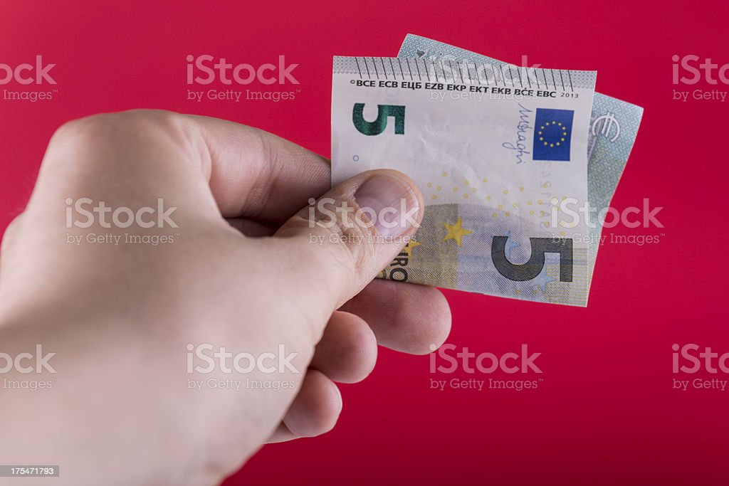Holding The New Five Euro Banknote stock photo