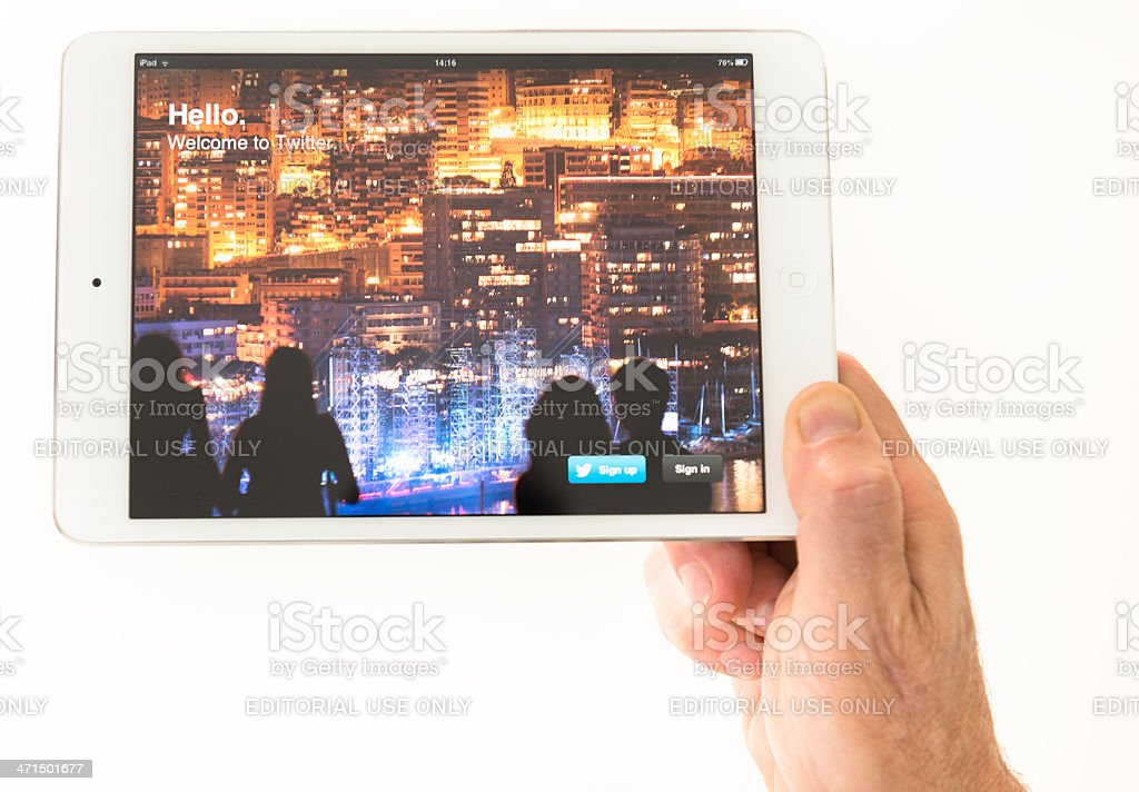 Holding the new Ipad Mini with twitter app page royalty-free stock photo
