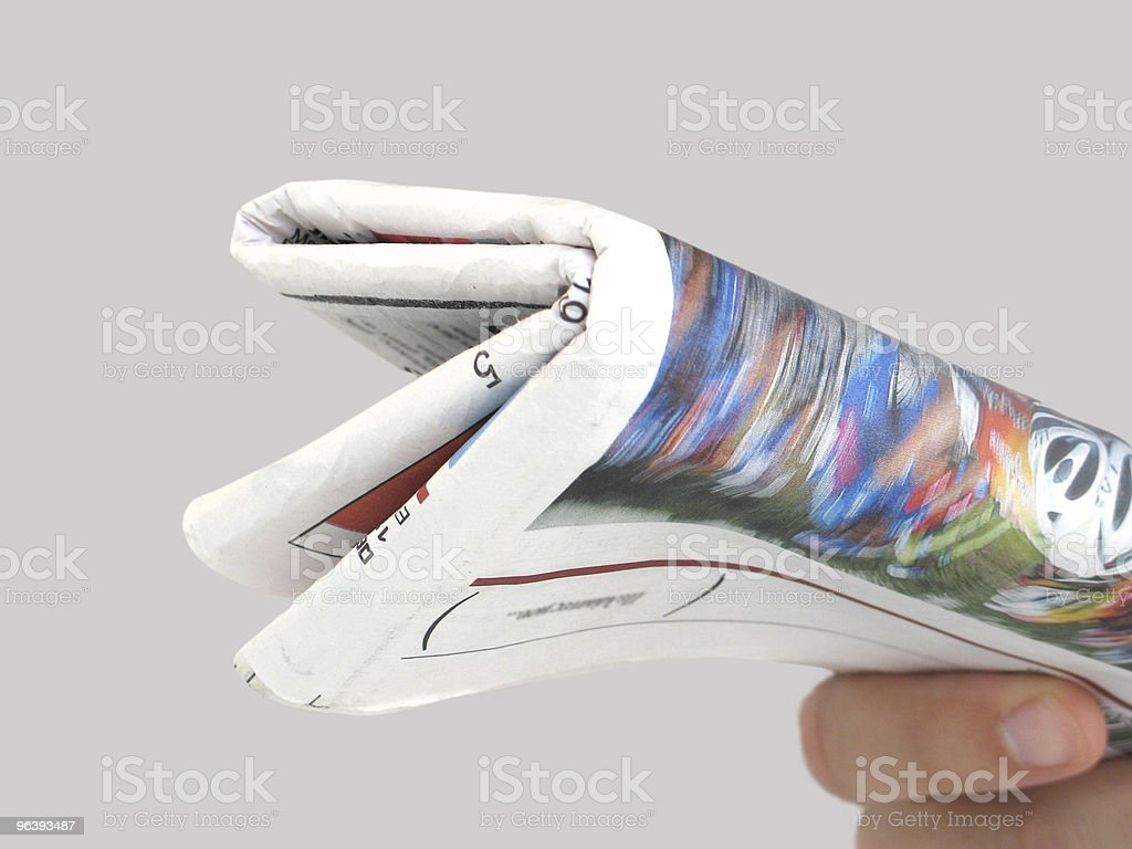 Holding the Newspaper royalty-free stock photo