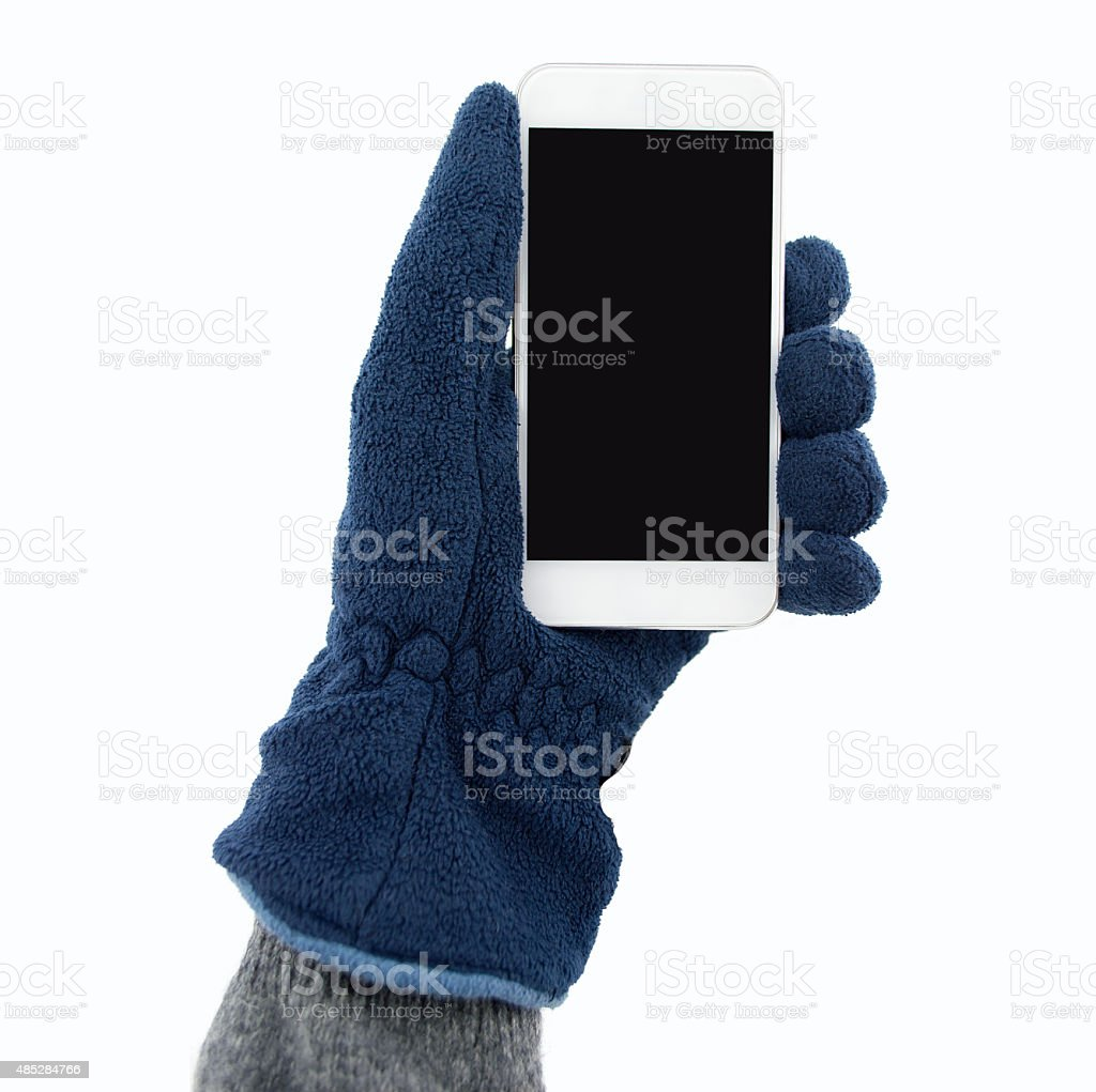 holding the smartphone with gloves stock photo