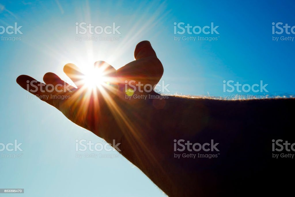 Holding the sun (with copyspace) stock photo