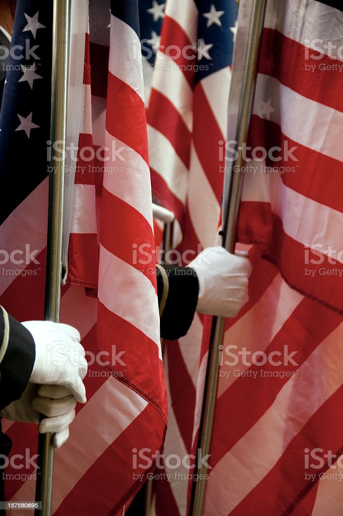 Holding the United States of America flags stock photo