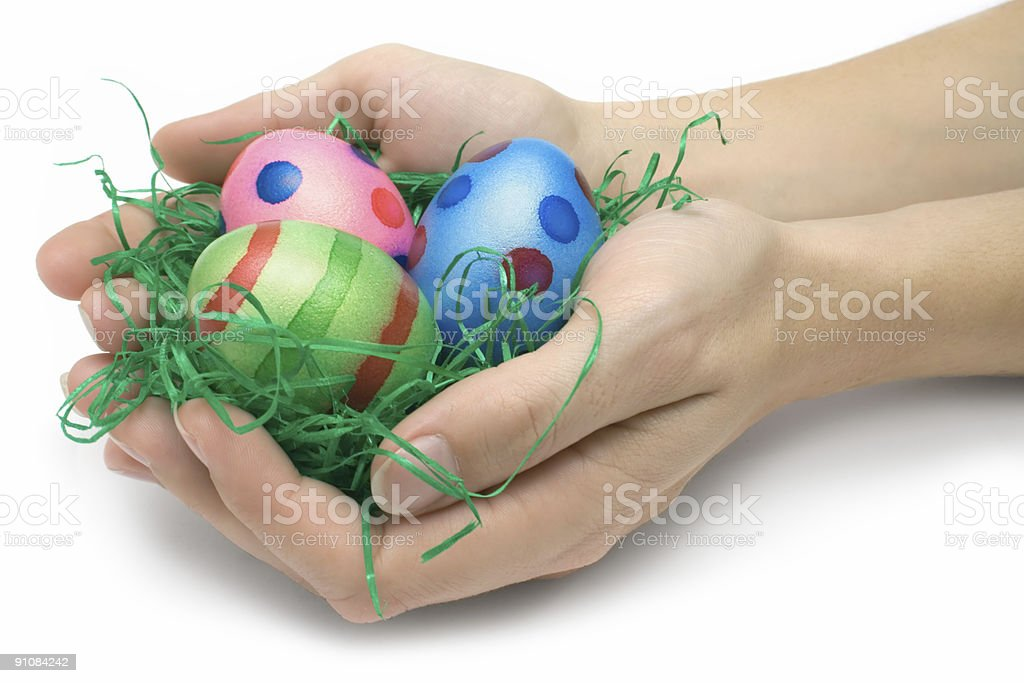 Holding Three Easter Eggs royalty-free stock photo