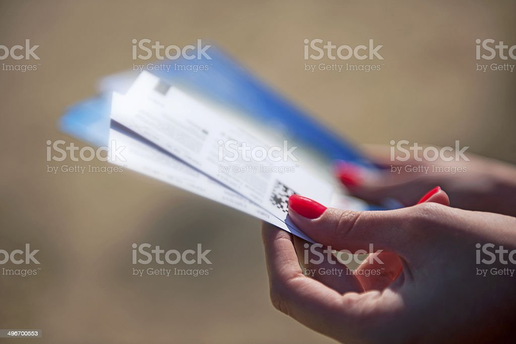 holding ticket stock photo