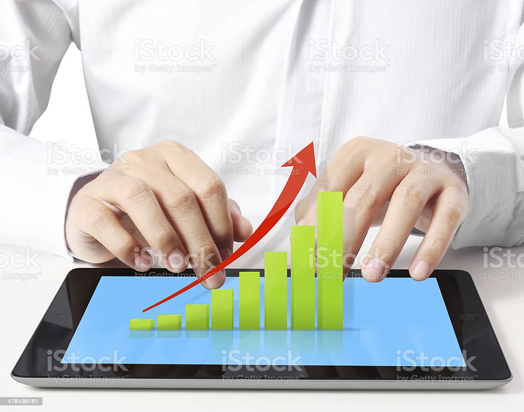 holding touch screen tablet with graph royalty-free stock photo