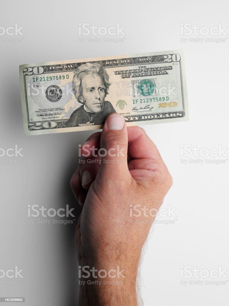 Holding Twenty American Dollars royalty-free stock photo