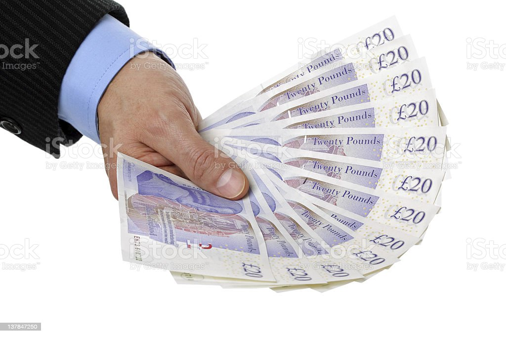 Holding twenty pound notes royalty-free stock photo