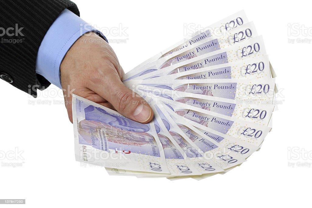 Holding twenty pound notes stock photo