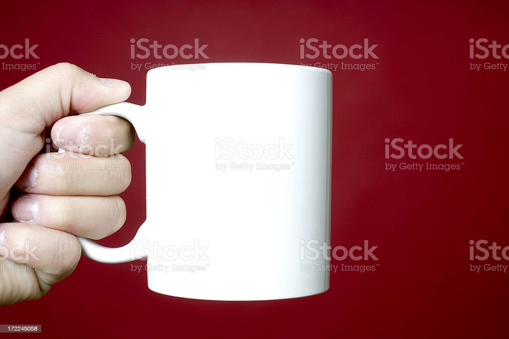Holding up a white coffee cup royalty-free stock photo