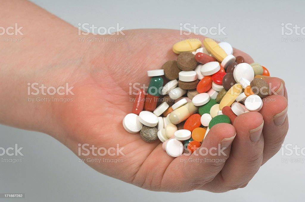 holding up drugs stock photo