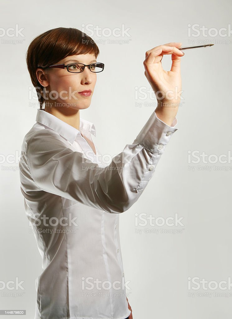 holding up pen royalty-free stock photo