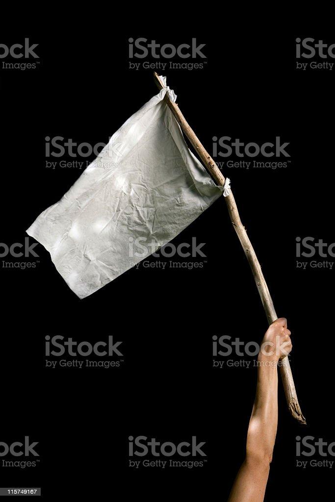 Holding up  white flag against a black background. stock photo