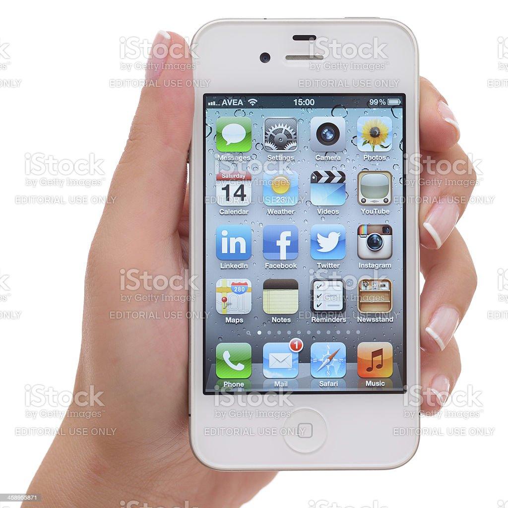 Holding white iPhone 4 royalty-free stock photo