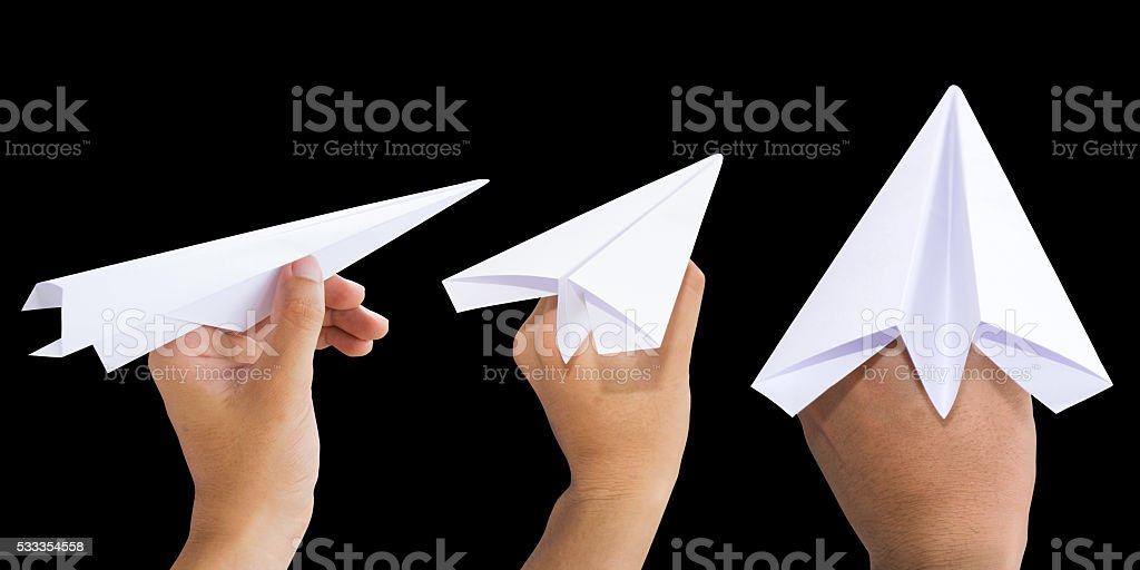 Holding White Paper rocket isolate on black background stock photo