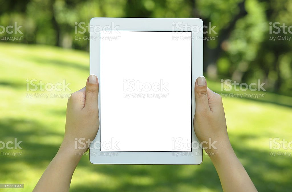 Holding white screen tablet pc in park royalty-free stock photo