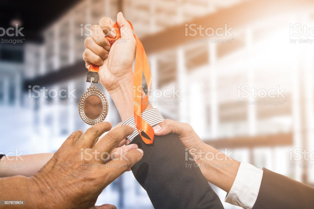 Holding winner's medal  awards stock photo