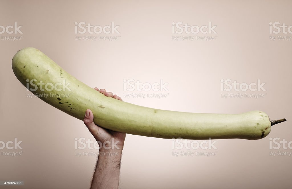 Holding with one hand a large vegetable stock photo