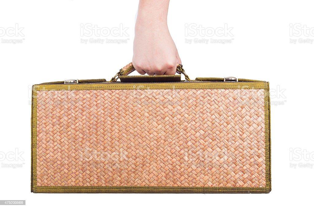holding wooden luggage rattan isolated on whitel background. stock photo