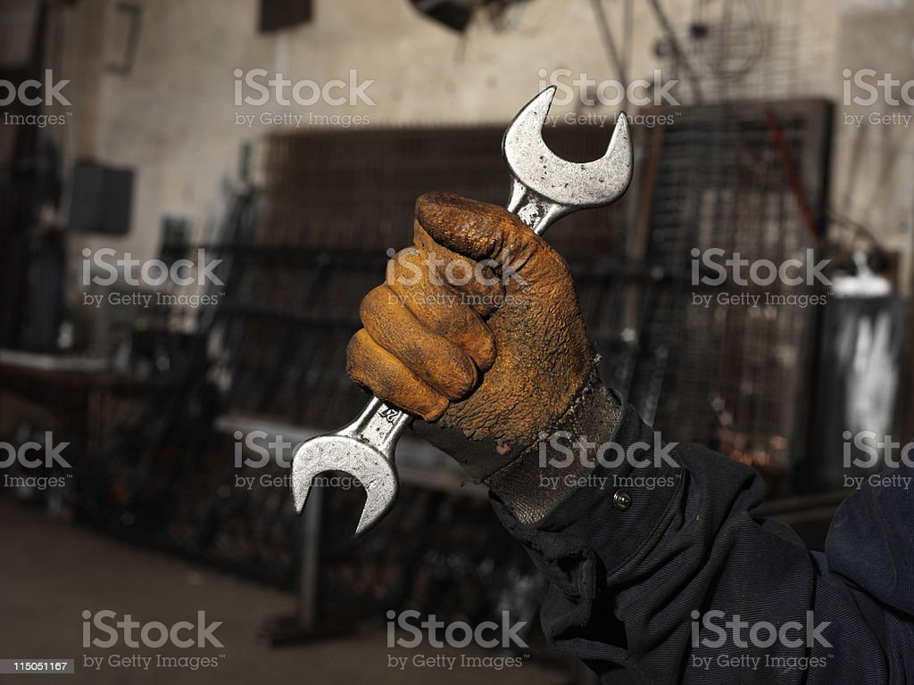 Holding wrench royalty-free stock photo
