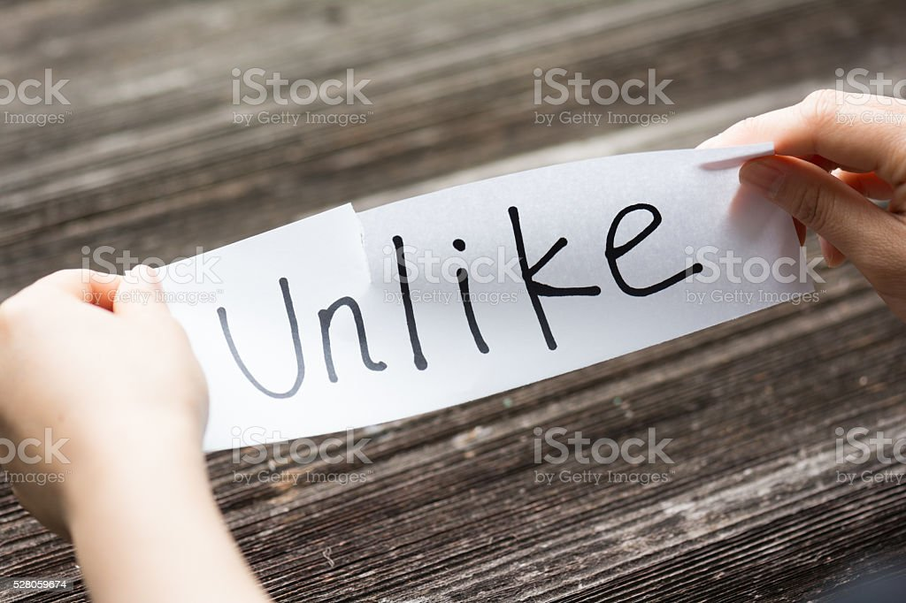 holds card with text on old wood plank stock photo