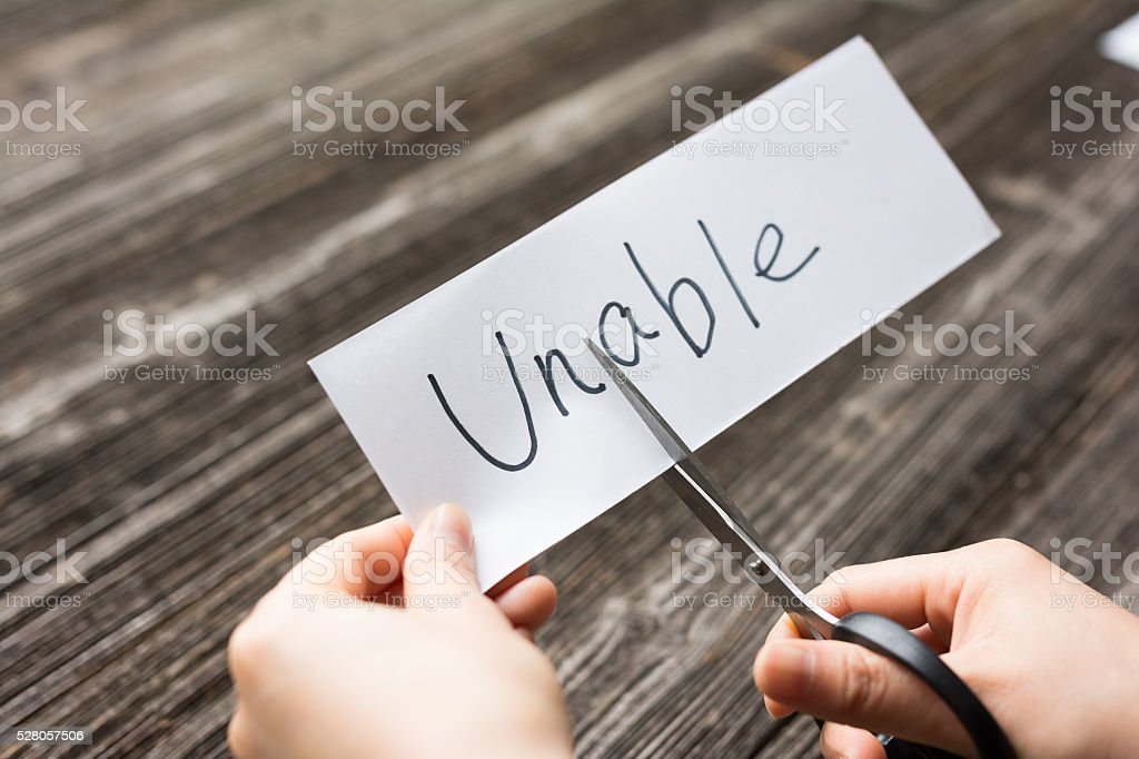 holds card with text unable on old wood plank stock photo