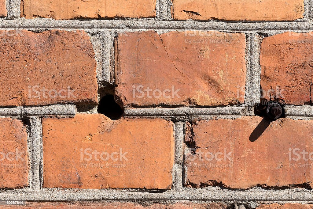 hole and a bolt brick background royalty-free stock photo