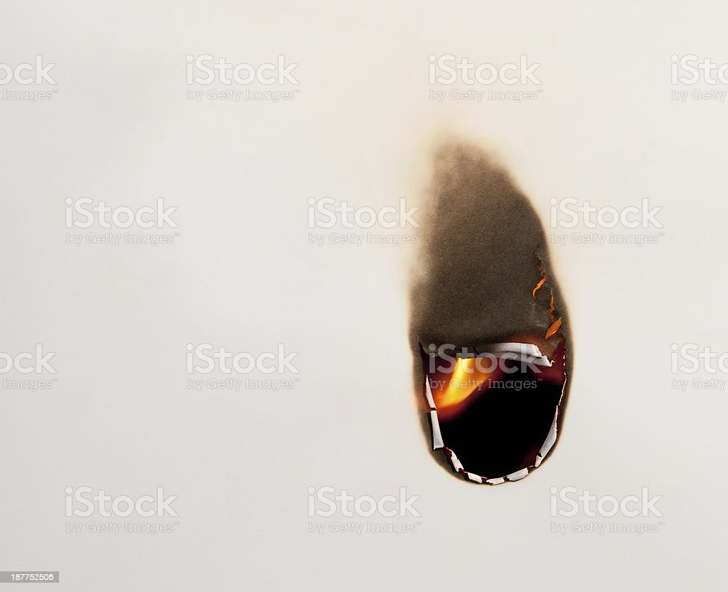 Hole burning in paper stock photo