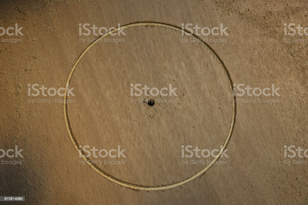 Hole cut in wood with sawdust stock photo