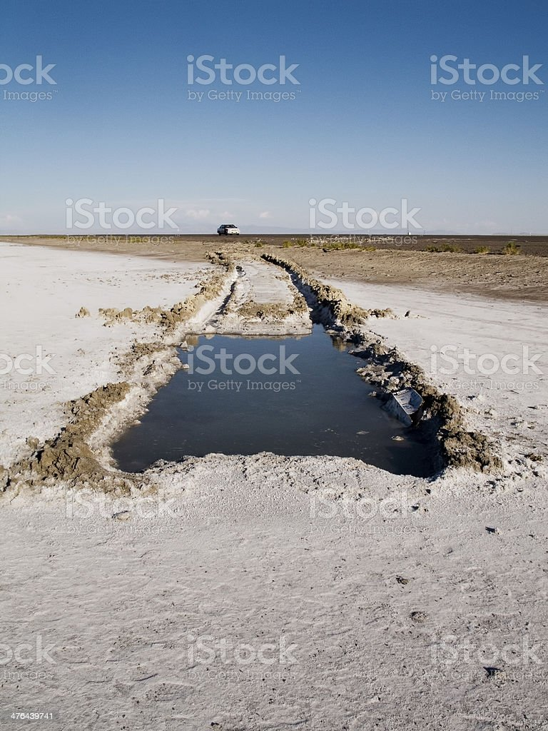 Hole exposed in Great Salt Lake Desert after vehicle wreck royalty-free stock photo