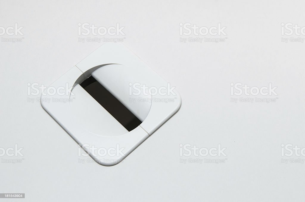 Hole for electric wire and cable on computer desk royalty-free stock photo